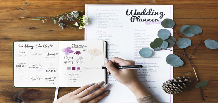 wedding-planner-checkist-woman-hands-writing-in-diary
